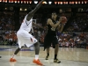 Josh Scott turns toward the basket looking to pass the ball. (Amy Leder/CU Independent)