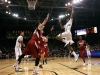 Xavier Johnson leaps for a dunk over two Stanford defenders. (Amy Leder/CU Independent)