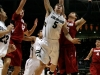 Eli Stalzer, center, goes up for a lay-up between two Stanford defenders. (Amy Leder/CU Independent)