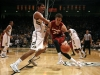 Josh Scott defends Stanford's Dwight Powell. (Amy Leder/CU Independent)