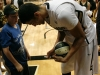 Andre Roberson autographs a basketball for a young fan after the 75-54 victory over Stanford. (Amy Leder/CU Independent)