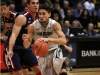 Sophomore guard Askia Booker goes past the Arizona player toward the basket. (James Bradbury/CU Independent)