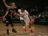 Junior guard Brittany Willson drives past Oregon State freshman guard Jamie Weisner. (Kai Casey/CU Independent)