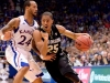 Askia Booker, against Travis Releford late in the second half. Colorado lost 54-90. (Andrew Kaczmarek/CU Independent)