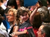 One of Obama's younger supporters waves her sign proudly. (James Bradbury/CU Independent)
