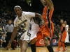 Freshman Xavier Johnson drives against an Oregon State defender. (Amy Leder/CU Independent)