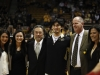 Senior Sabatino Chen poses with his family and coach Tad Boyle before the start of the game. (Robert R. Denton/CU Independent)