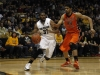 Jeremy Adams drives against Devon Collier of Oregon State. (Robert R. Denton/CU Independent)