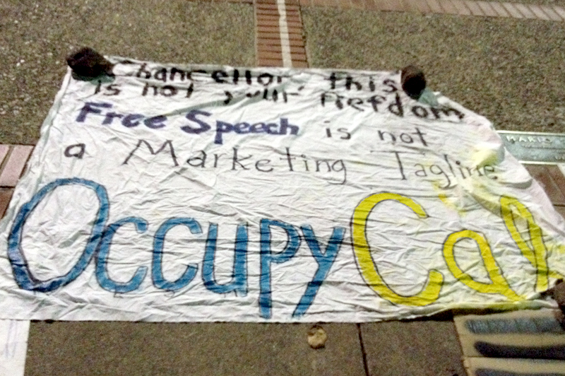 A sign made by Occupy Cal protestors. Occupy Cal has been in the news recently because of incidents between police and protestors. (CU Independent/Sara Kassabian)