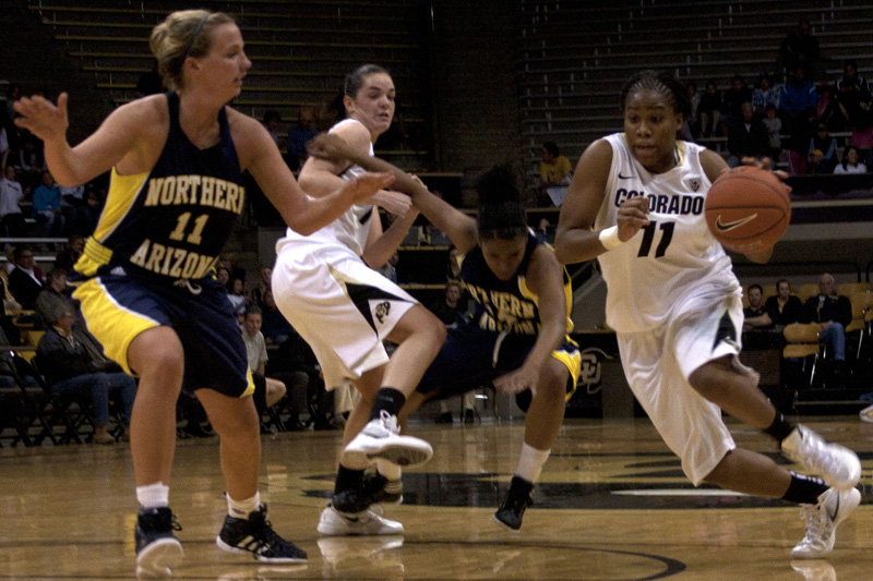Brittany Wilson, 11, drives past the Northern Arizona Lumberjacks' Katie Pratt. The Buffs won the game 84-60. (CU Independent/Elaine Cromie)