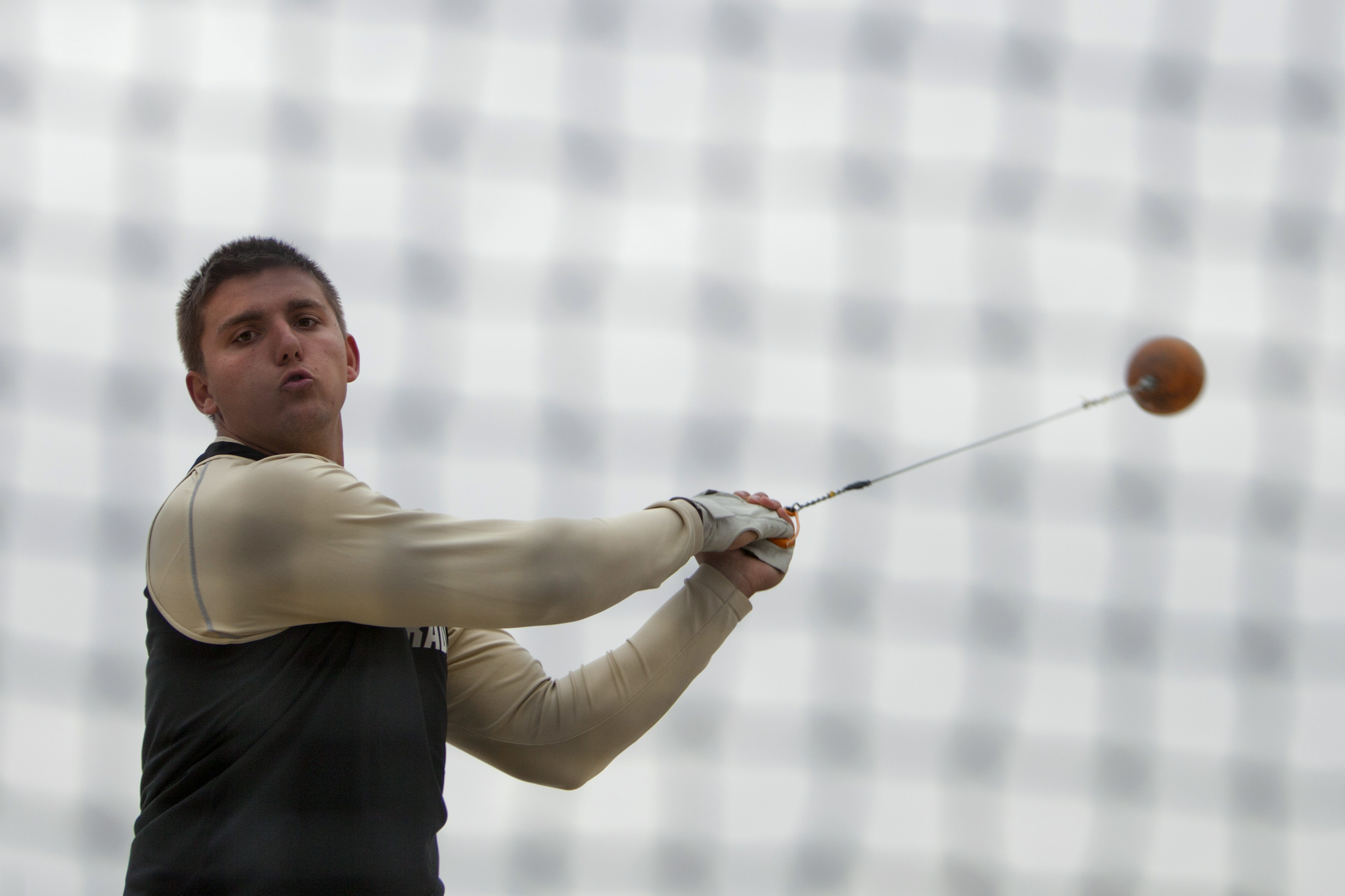 Sophomore thrower Alexandre Kizirian swings the hammer on Friday at the CU Invitational at Potts Field. Kizirian came in second with a throw of 57.04 meters. (CU Independent/Robert R. Denton)