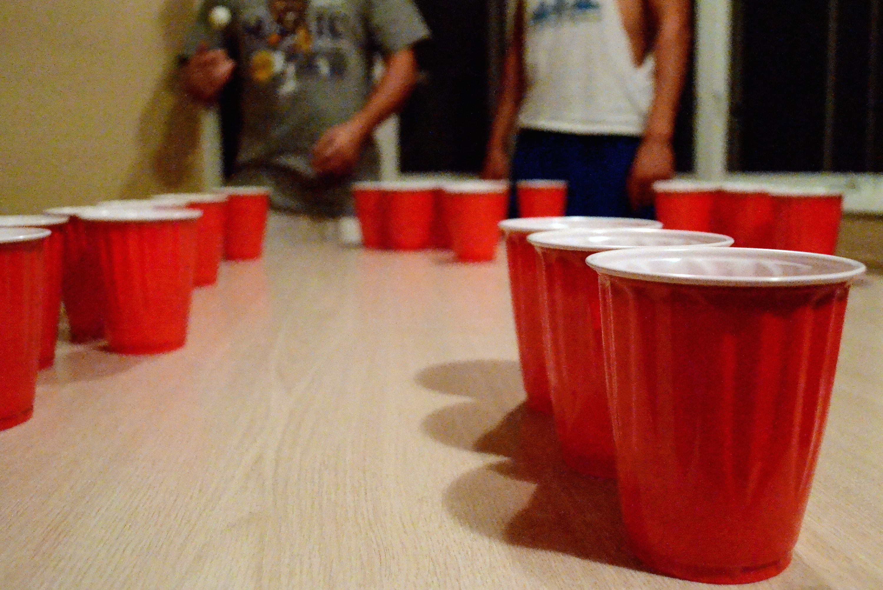 CU students partake in a friendly game of beer pong.  Nobody wants to bring down their teammate by not making any cups. (Nate Bruzdzinski/CU Independent File)