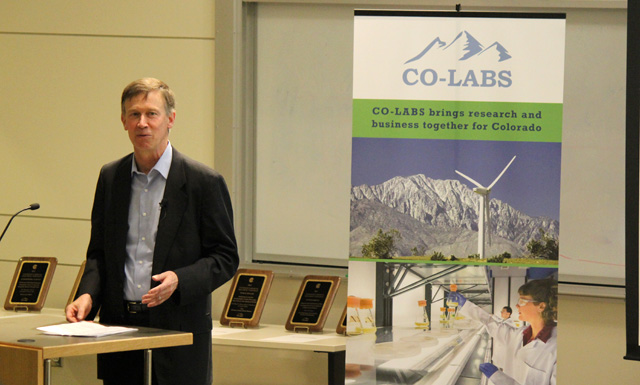 Gov. John Hickenlooper on East Campus Thursday presenting a research award to a CU team. (Haleema Mian/CU Independent)