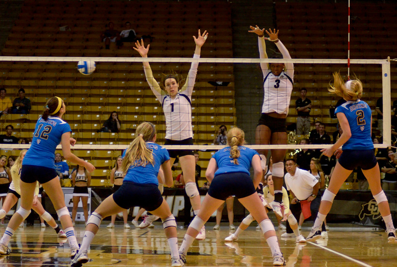 Kelsey English and Alexis Austin attempt to deffend the UCLA spike in the second match. The Buffs lost to the UCLA Bruins 0-3. (Andrew Kaczmarek/CU Independent)