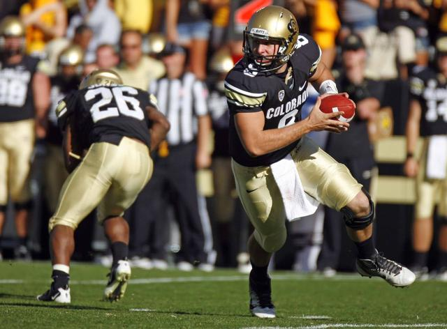 Quarterback Nick Hirschman scrambles to find an open receiver Oct. 22, 2011 against Oregon. On Saturday Hirschman started when the Buffs fell to the Arizona Wildcats in Tuscon 56-31. (James Bradbury/CU Independent File)