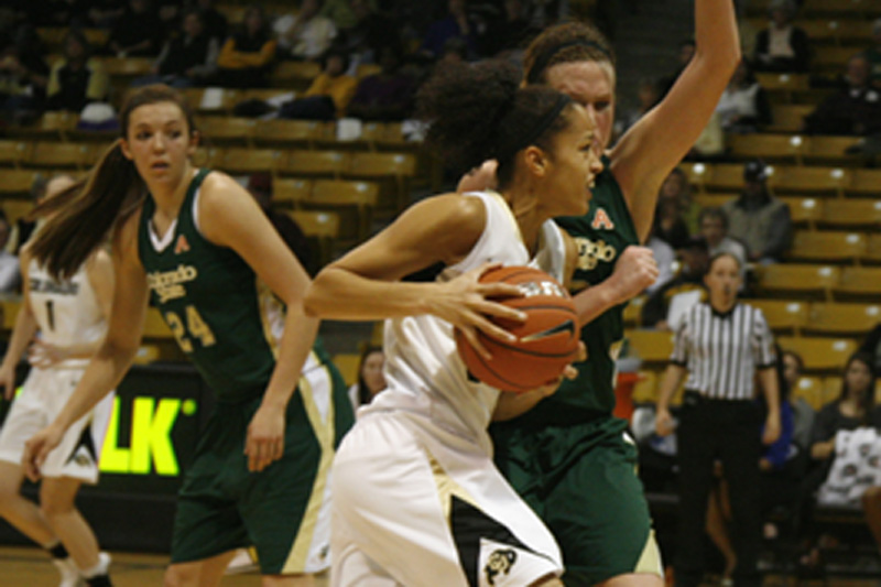 Freshman Arielle Roberson runs through the CSU defender on her way to the basket. (Amy Leder/CU Independent)