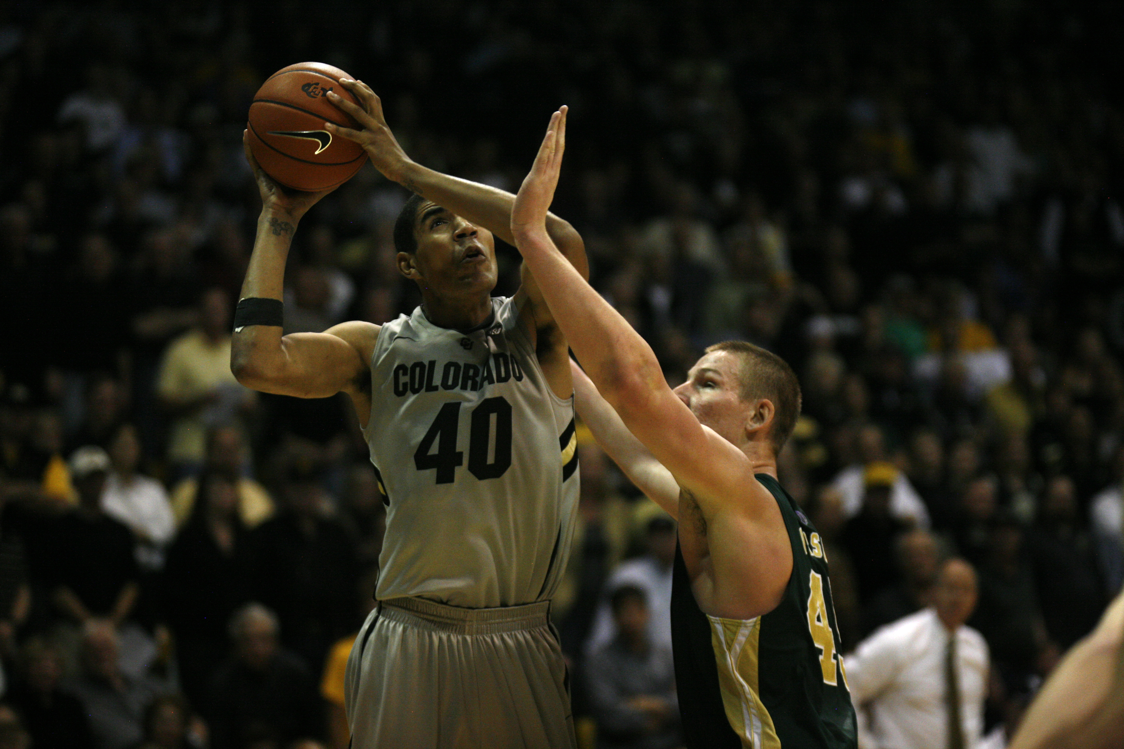 Josh Scott fights to put up a shot against CSU's Colton Iverson during the game on Wednesday, Dec. 5, 2012 at the Coors Events Center. (Kai Casey/CU Independent file)