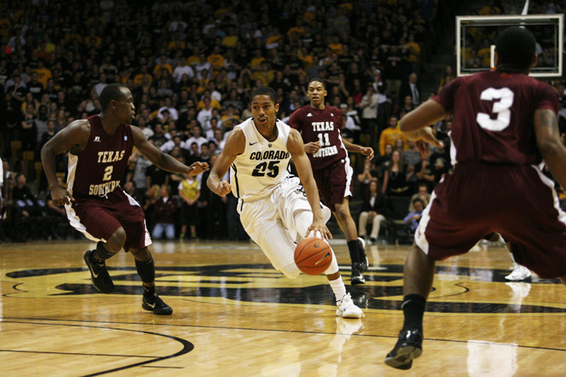 Spencer Dinwiddie drives against a Texas Southern defender in this file photo from Nov. 27, 2012. (Amy Leder/CU Independent File)