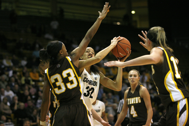 Freshman Arielle Roberson fights past Wyoming's Chaundra Sewell to put up a shot on Wednesday, Nov. 29, 2012 at the Coors Events Center. Roberson finished with 14 points, shooting 60 percent from the floor. (Kai Casey/CU Independent file)