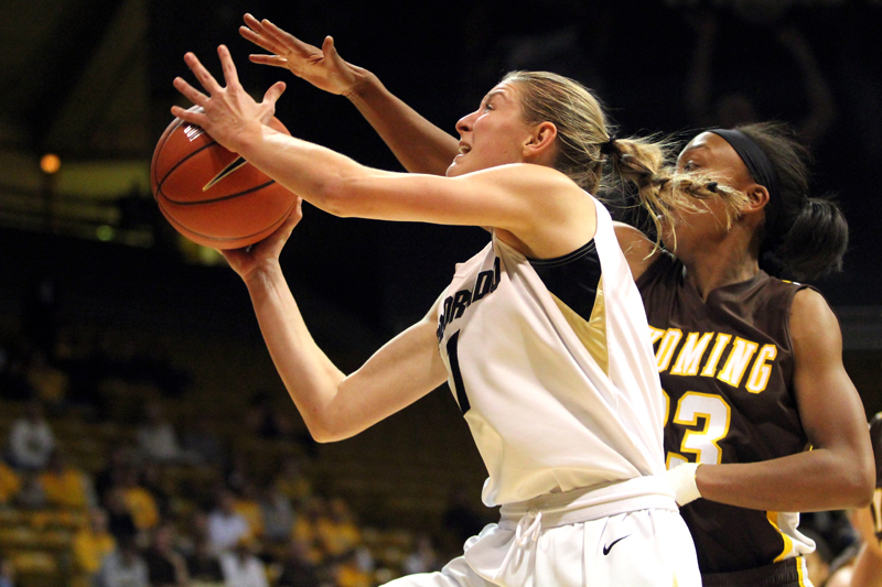 Sophomore guard Lexy Kresl attempts a lay-up against Wyoming's Chaundra Sewell during a game on Nov. 28, 2012 at the Coors Events Center. . (Kai Casey/CU Independent)
