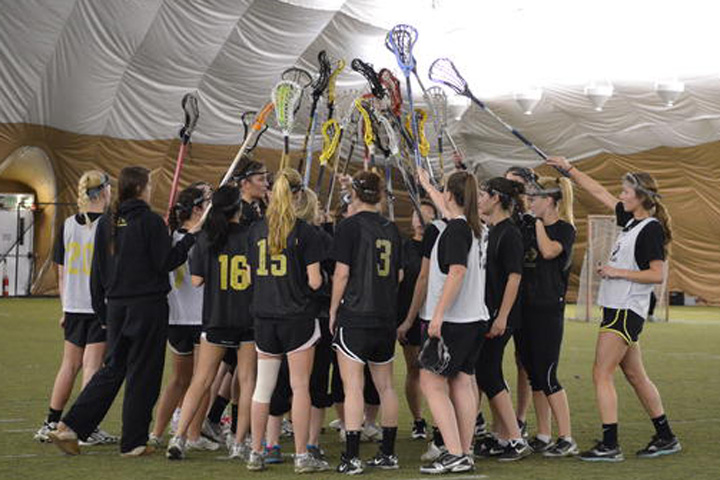 The CU women's lacrosse team gathers during practice on Wednesday. Women's lacrosse became the newest Division 1 sport at CU. (Annie Rumbles/CU Independent)