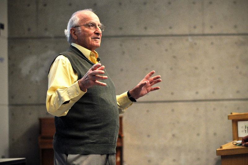 Social entrepreneur and author Paul Polak speaks Monday night in Math 100. (James Bradbury/CU Independent)