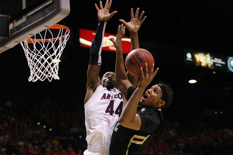 Xavier Johnson goes up for a layup past Arizona's Soloman Hill on Thursday, March 14 at the Pac-12 Tournament in Las Vegas. (Kai Casey/CU Independent File)