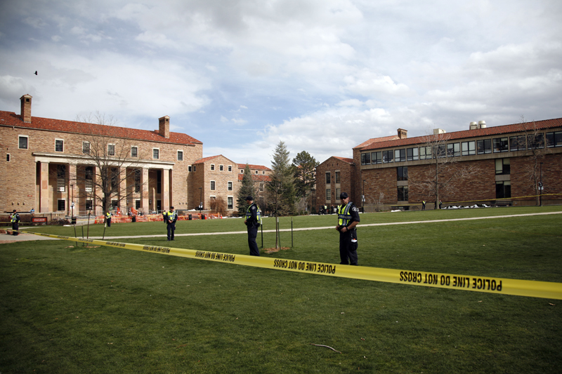 Police Officers stand guard on an empty Norlin Quad at 4:22 p.m. on April 20, 2013 in Boulder, Colo. (Kai Casey/CU Independent)