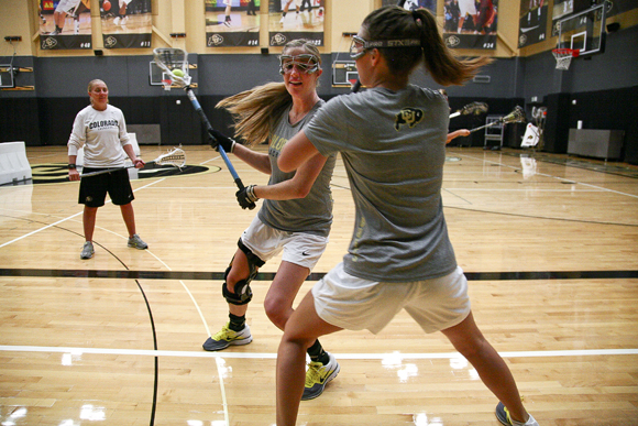 Marie Moore, left, and Annie Morsches run through a ball possession drill during an individuals practice in the Coors Events Center. (Kai Casey/CU Independent File)
