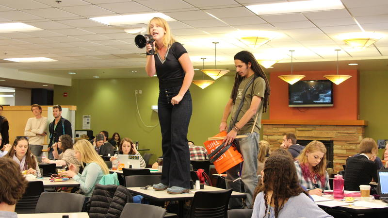 CU PHD student Simon Mostama and Watson University scholar Katie Raitz bring the protest to the UMC with drums and calls for student to stand up against fossile fuels. (Gray Bender/CU Independent File)