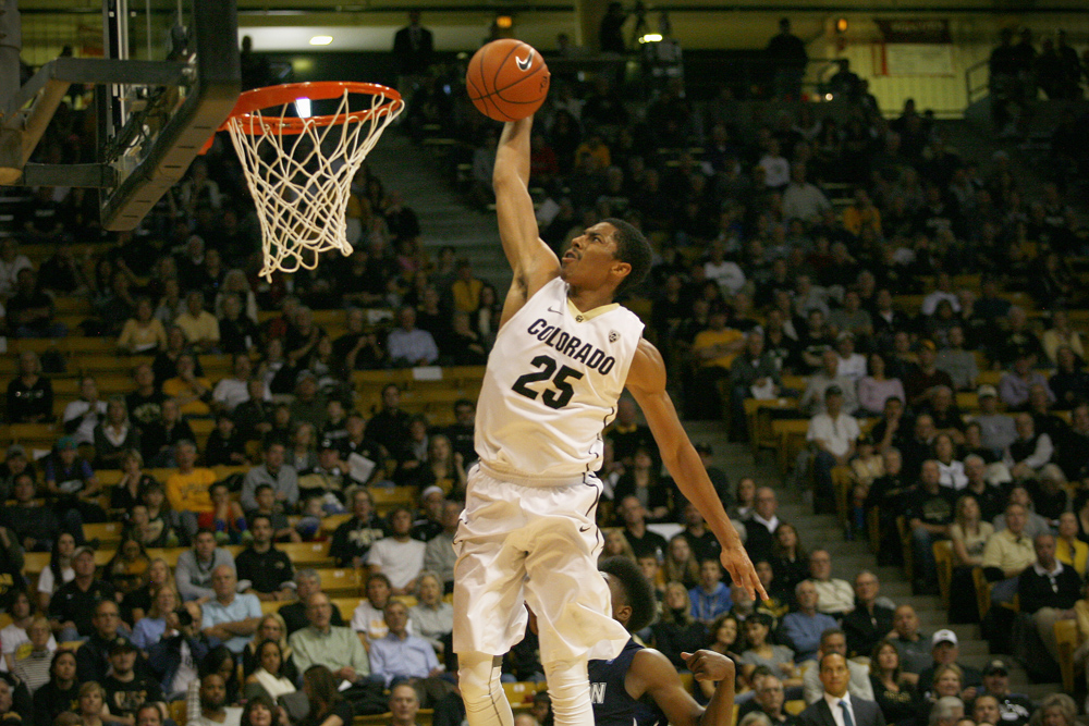 Guard Spencer Dinwiddie dunks during the second half of Colorado's 94-70 win over Jackson State. Dinwiddie finished with 11 points. (James Bradbury/CU Independent)