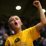 A young Colorado fan cheers after the Buffs started to pull away late. (Kai Casey/CU Independent)