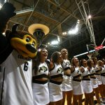 Colorado mascot Chip and Colorado cheerleaders sing the alma mater after Colorado defeated Harvard 70-62 at the Coors Events Center in Boulder, Colo. (Kai Casey/CU Independent)