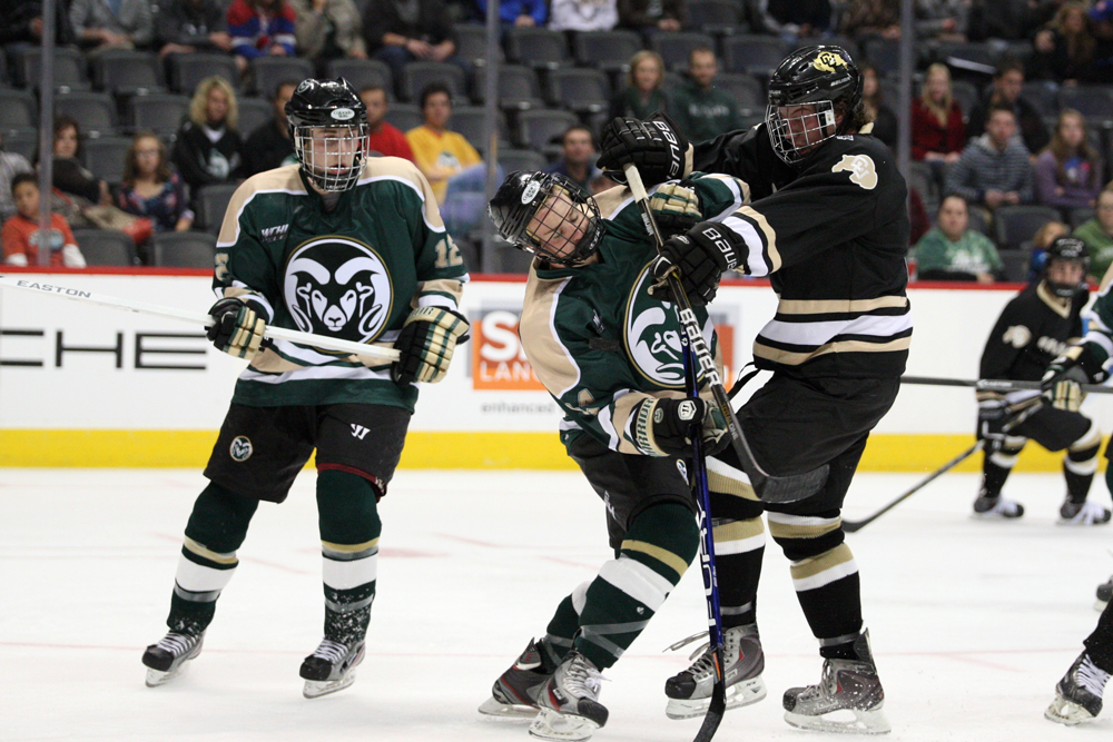 Sophomore forward Eddie Lang (7) battles for a loose puck in the offensive zone during the Rocky Mountain Center Ice Showdown, Oct. 19, 2013 at the Pepsi Center in Denver. (Bryan Borenstein/CU Independent File)