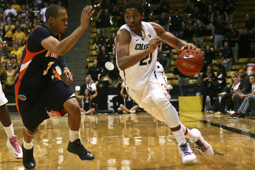 Spencer Dinwiddie (25) dribbles past a UT Martin defender, Nov. 11, 2013. (Nate Bruzdzinski/CU Independent)