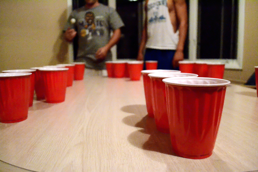 CU students partake in a friendly game of beer pong.  Nobody wants to bring down their teammate and not make any cups. (Nate Bruzdzinski/CU Independent Photo Illustration)