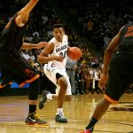 Freshman George King looks for room against the Trojan defense. (James Bradbury/CU Independent)