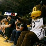 Chip watches part of the first half from the front row. (James Bradbury/CU Independent)