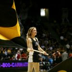 A Colorado cheerleader helps spell C-O-L-O-R-A-D-O. (James Bradbury/CU Independent)