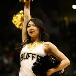 A CU cheerleader performs just before the start of the game. (Kai Casey/CU Independent)