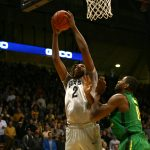 Colorado sophomore forward Xavier Johnson (2) jumps for a layup over Oregon's Mike Moser (0). (Kai Casey/CU Independent)