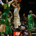 Colorado junior guard Spencer Dinwiddie (25) braces for contact while going up for a shot against Oregon's Ben Carter (32). (Kai Casey/CU Independent)
