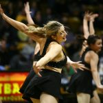 A member of the Colorado dance team performs during halftime. (Kai Casey/CU Independent)