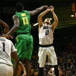 Oregon senior forward Richard Amardi (13) blocks the shot of Colorado junior guard Askia Booker (0). (Kai Casey/CU Independent)