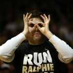 "A Colorado fan wears ""3 goggles"" while celebrating a Colorado 3-pointer. (Kai Casey/CU Independent)"