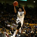 Colorado senior guard Ashley Wilson (12) goes up for an uncontested layup. (Kai Casey/CU Independent)
