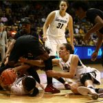 Colorado's Ashley Wilson (12) and Haley Smith (22) fight with a couple Arizona State players for a loose ball. (Kai Casey/CU Independent)