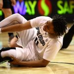 Colorado senior guard Brittany Wilson (11) grimaces as she grabs her ankle after falling to the ground. (Kai Casey/CU Independent)
