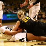 Colorado sophomore forward Jamee Swan (50) looks toward the referee while battling for a loose ball with Arizona State's Kelsey Moos (24). (Kai Casey/CU Independent)