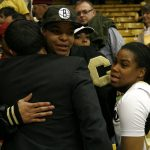 Colorado senior guard Ashley Wilson, right, hugs former CU women's basketball star and current WNBA player Chucky Jeffery after losing to No. 14 Arizona State. (Kai Casey/CU Independent)